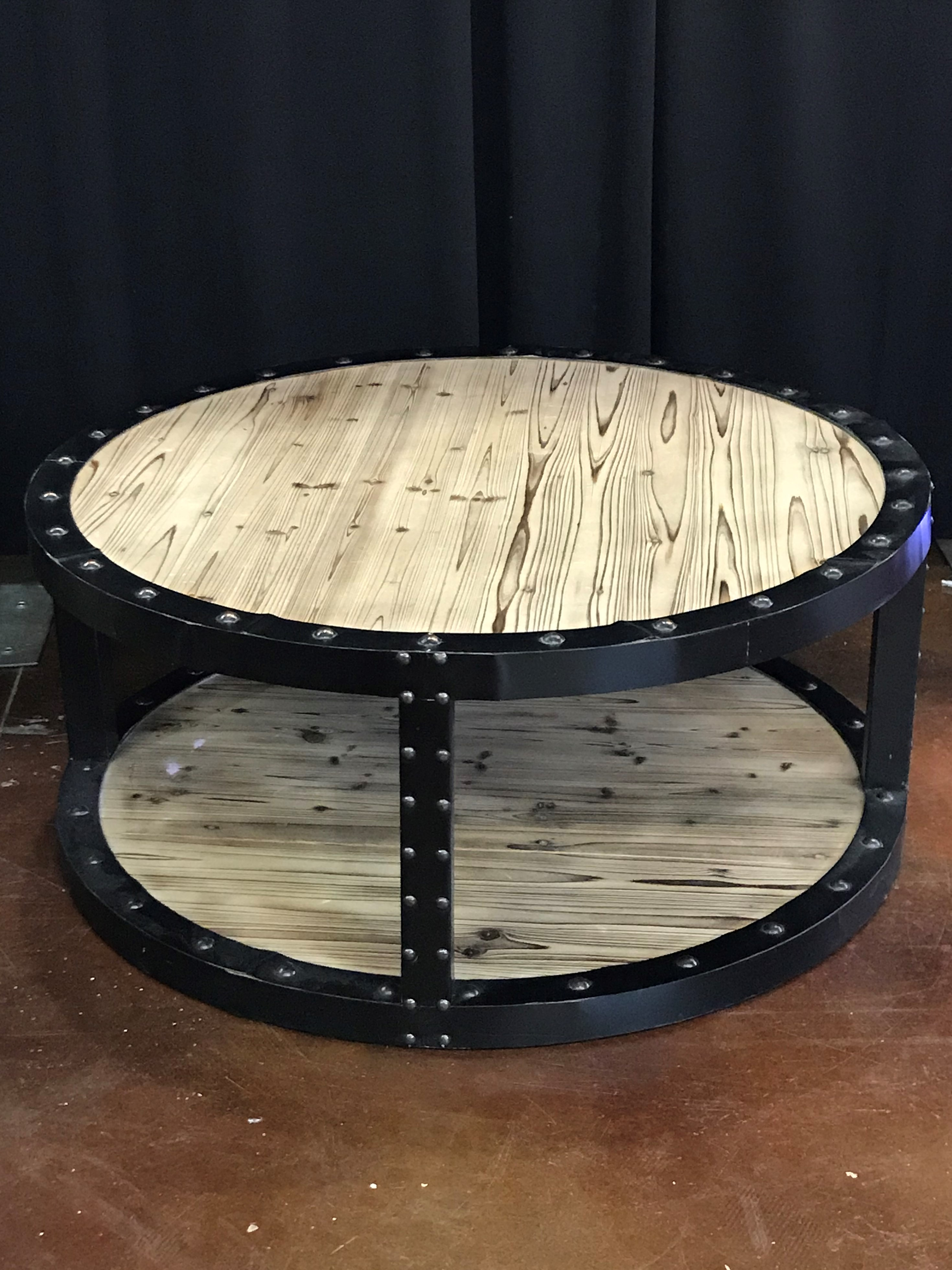 Round Wooden Coffee Table With Onyx Metal Frame Detail Rental